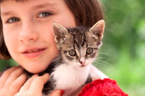Little girl holding kitten